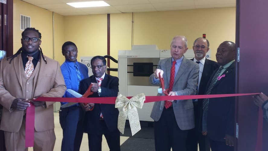 The Air Force Research Laboratory, Central State University (CSU), and Universal Technology Corporation (UTC) cut the ribbon for the new Additive Manufacturing Laboratory, making CSU the first university in the region with metal additive manufacturing capability.  Pictured from left to right are CSU students Mr. Jamal Robinson and Mr. Priestly Schuler, Dr. Subramania Sritharan (Dean of Science and Engineering, CSU), Dr. Charles Browning (Chairperson, Department of Chemical and Materials Engineering, University of Dayton), Mr. Joe Sciabica (President, UTC), and Dr. Charles Wesley Ford, Jr. (Provost and VP, CSU).  (Photo courtesy of Central State University)