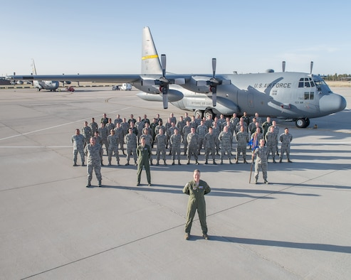 Airmen assigned to the 30th Airlift Squadron pose in front of a C-130H Hercules aircraft assigned to the 153rd Airlift Wing, Wyoming Air National Guard, Apr. 7, 2015 in Cheyenne, Wyoming. The 30th Airlift Squadron is the first active duty associate squadron assigned to the Air National Guard. (U.S. Air National Guard photo by Master Sgt. Charles Delano/released)
