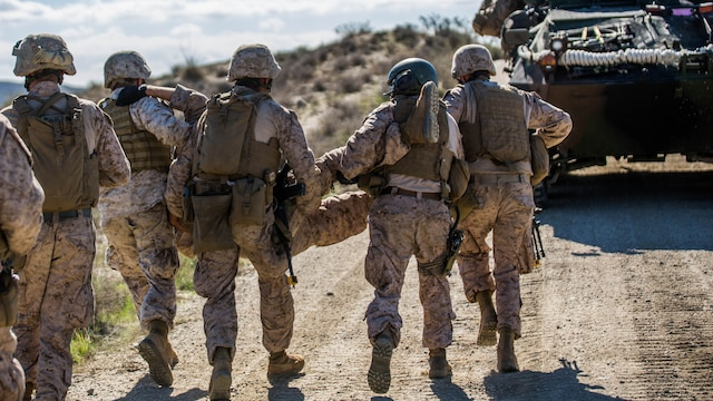 Marines with 4th Light Armored Reconnaissance Battalion, 4th Marine Division, simulate a casualty evacuation during exercise Trident Juncture 2015 in Almería, Spain, Oct. 31, 2015. The exercise provided an opportunity for Reserve Marines to gain experience within their military occupational specialty and demonstrates their readiness in conjunction with other foreign nationals.