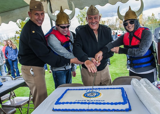 After the regatta race, Navy Rear Adm. John King, DLA Land and Maritime commander, and others cut the cake to launch post-race birthday activities at Eagle Eye Golf Course Oct. 16.
