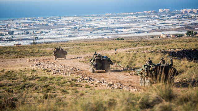 Marines with 4th Light Armored Reconnaissance Battalion, 4th Marine Division, convoy during their final exercise in Trident Juncture, Oct. 28, 2015. The simulated exercise taught the Marines each other's strengths and weaknesses, allowing them to seek improvement as well as build interoperability among the warfighters.