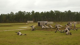 "Marines with 1st Battalion, 6th Marine Regiment, assault an objective during a platoon-reinforced attack at Marine Corps Base Camp Lejeune, N.C., Oct. 28, 2015. ""What I truly hope my Marines take from this training is that they build that implicit communication and that mutual trust between each other. I want them to know the Marines on the support by fire position are covering them so the Marines in the assault know they are able to lean into those fires in order to stay covered while destroying the enemy on the objective,"" said 1st Lt. Mark Dela Pena, a platoon commander with the unit. The battalion is conducting this training in order to prepare for their upcoming deployment on the 22nd Marine Expeditionary Unit next year."
