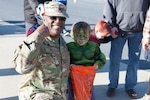 DLA Distribution commander Army Brig. Gen. Richard B. Dix stands with The Hulk during the parade at Defense Distribution Center, Susquehanna on Oct. 30.