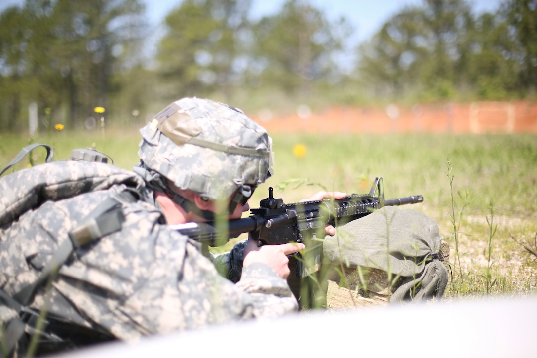 Staff Sgt. Andrew Fink, a combat medic, representing the 807th Medical Command (Deployment Support), zeroes his M4 during the 2015 U.S. Army Reserve Best Warrior Competition at Fort Bragg, N.C., May 5. This year's Best Warrior competition will determine the top noncommissioned officer and junior enlisted Soldier who will represent the Army Reserve in the Department of the Army Best Warrior competition later this year at Fort Lee, Va. (U.S. Army photo by Staff Sgt. Sharilyn Wells/Released)