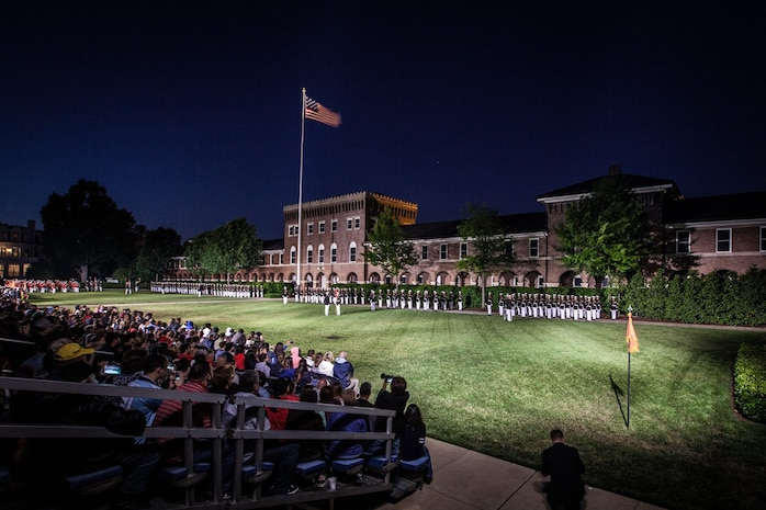 An Evening Parade is held at Marine Barracks Washington, D.C., May 22, 2015. . The Evening Parade summer tradition began in 1934 and features the Silent Drill Platoon, the U.S. Marine Band, and the U.S. Marine Drum and Bugle Corps, and two marching companies. More than 3,500 guests attend the parade every week. (U.S. Marine Corps photo by Sgt. Melissa Marnell/Released)