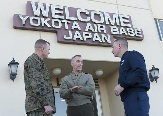 U.S. Marine Corps Gen. Joseph F. Dunford Jr., center, chairman of the Joint Chiefs of Staff, speaks with U.S. Air Force Lt. Gen. John L. Dolan, commander of U.S. Forces Japan, right, and his deputy, U.S. Marine Corps Brig. Gen. Mark Wise, before departing Yokota Air Base, Japan, Nov. 4, 2015. DoD photo by U.S. Navy Petty Officer 2nd Class Dominique A. Pineiro