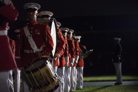 """The """"Field Crew"""" element of the The United States Marine Drum & Bugle Corps consists of 36 Marines. Highlighted by the thunderous sounds of the traditional rope tension drums, their contribution of the musical entertainment is always a crowd favorite."""