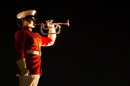 Ceremonial Bugler, Staff Sergeant Codie Williams, performs Taps in conclusion to the Evening Parade at Marine Barracks Washington, D.C., June 12. (Official Marine Corps photo by Cpl. Chi Nguyen/Released)