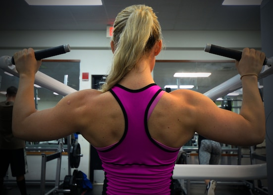 Senior Airman Kelly Berger, 36th Civil Engineer Squadron pest management journeyman, performs a lat pulldown Oct. 2, 2015, at Andersen Air Force Base, Guam.  In September, Berger competed in and placed first in her division in the 2015 Guam National Fitness Championships and International Invitational. (U.S. Air Force photo by Senior Airman Joshua Smoot/Released)