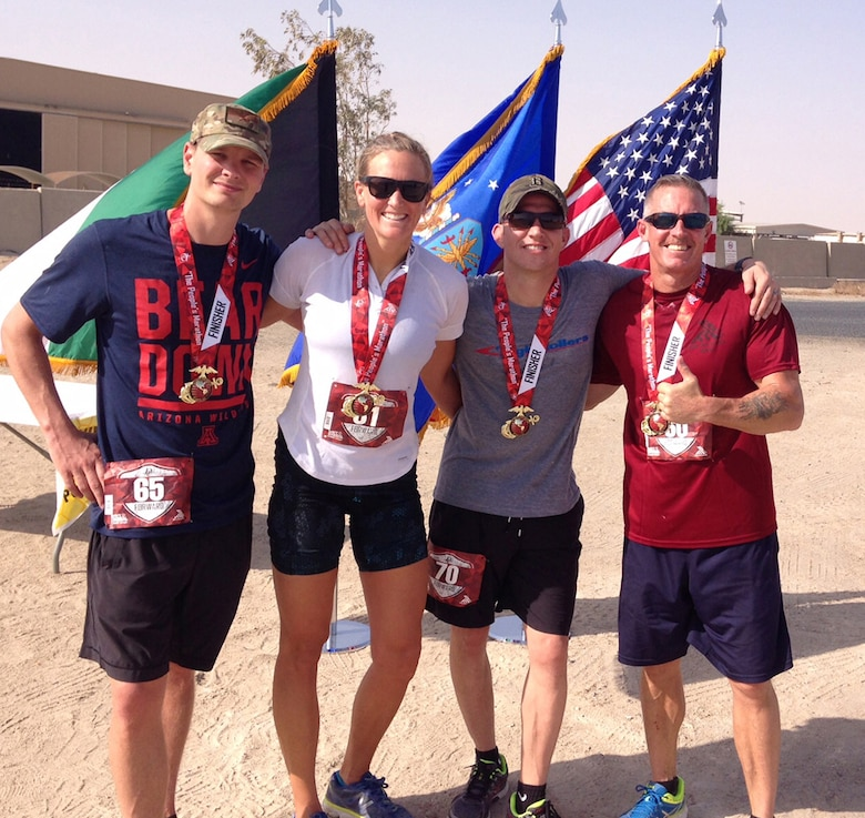 High Roller Deployers, (from left to right), Capt. Reed Kobernick, Capt. Merridy Stephenson, Master Sgt. Lyle Smith and Chief Master Sgt. Thomas Glover who all participated in the Marine Corps Marathon Forward. (Photo by a unnamed volunteer.)