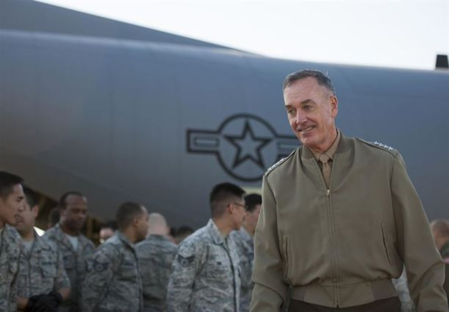 U.S. Marine Corps Gen. Joseph F. Dunford Jr., chairman of the Joint Chiefs of Staff, meets on the flightline of Yokota Air Base, Japan, with U.S. airmen assigned the 374th Airlift Wing, Nov. 4, 2015. (DoD photo by U.S. Navy Petty Officer 2nd Class Dominique A. Pineiro)