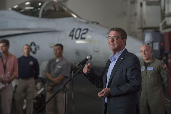 U.S Defense Secretary Ash Carter speaks with U.S. service members on the USS Theodore Roosevelt  as he and Malaysian Defense Minister Hishammuddin Hussein visit the aircraft carrier Nov. 5, 2015. DoD photo by Air Force Senior Master Sgt. Adrian Cadiz