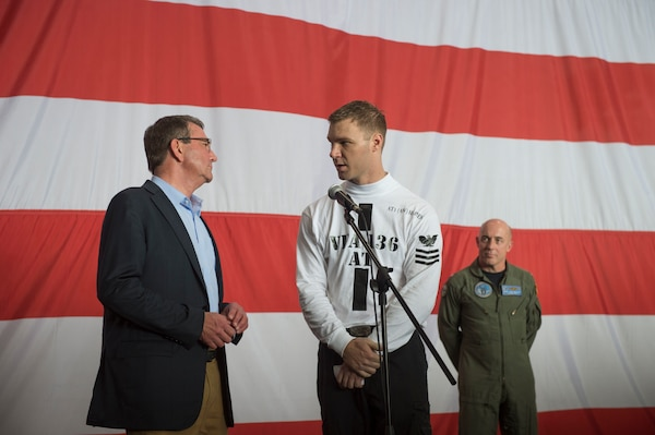 U.S. Defense Secretary Ash Carter, left, speaks with a U.S. Navy petty officer first class on the USS Theodore Roosevelt as he and Malaysian Defense Minister Hishammuddin Hussein visit the aircraft carrier Nov. 5, 2015. DoD photo by Air Force Senior Master Sgt. Adrian Cadiz
