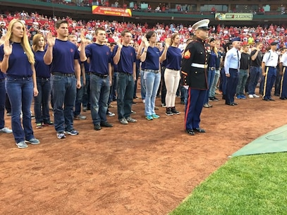 Marine Corps Poolees take part in a sware0in ceremony at Busch Stadium, St. Louis September 27. The swear-in was part of a military appreciation day.