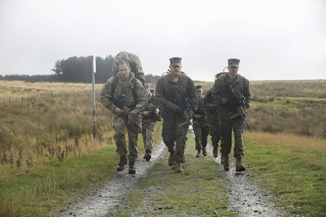 U.S. Marine Lance Cpl. Jason Shillingburg, center, and Lance Cpl. Mason Foth, right, execute a three-mile conditioning hike with other U.S. Marines and British soldiers during Exercise Phoenix Odyssey II near Edinburgh, U.K., Oct. 30, 2015. Shillingburg and Foth are both intelligence specialists with 2nd Intelligence Battalion. The Marines and their British counterparts are currently working to enhance joint intelligence operations and military skills for potential real-world contingencies. (U.S. Marine Corps photo by Cpl. Lucas Hopkins/Released)