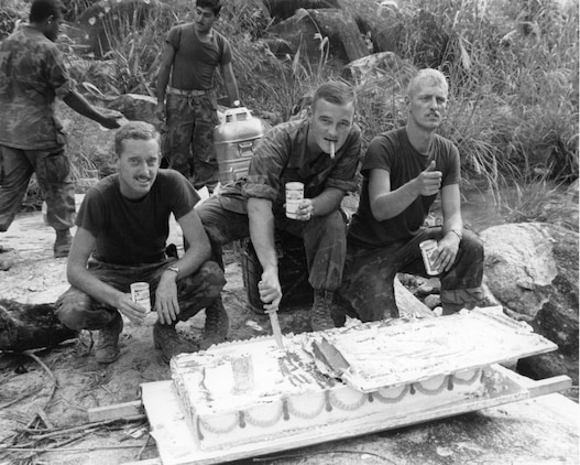 1st Lt. Raymond Horn, Charlie Company 1/7, 1st Marine Division, commanding officer, cuts a piece of cake to celebrate the Marine Corps Birthday birthday n Vietnam in 1969.