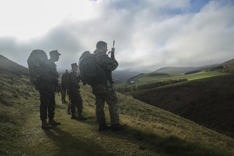 U.S. Marines with 2nd Intelligence Battalion and British soldiers search for a checkpoint during Exercise Phoenix Odyssey II near Edinburgh, U.K., Oct. 30, 2015. The service members executed a three-mile conditioning hike and shooting competition as part of the exercise, which is designed to enhance joint intelligence operations. (U.S. Marines Corps photo by Cpl. Lucas Hopkins/Released)