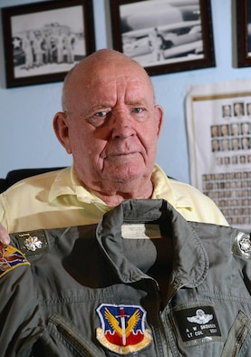 Retired Lt. Col. Alma Skousen shows off his flight suit Oct. 30, 2015, in his Mesa, Ariz., home. Skousen flew combat missions in the Korean and Vietnam wars and was awarded the Distinguished Flying Cross for acts of heroism and extraordinary achievement while participating in an aerial flight. Skousen ended his flying career with more than 6,000 flying hours. (U.S. Air Force photo/Tech. Sgt. Timothy Boyer)