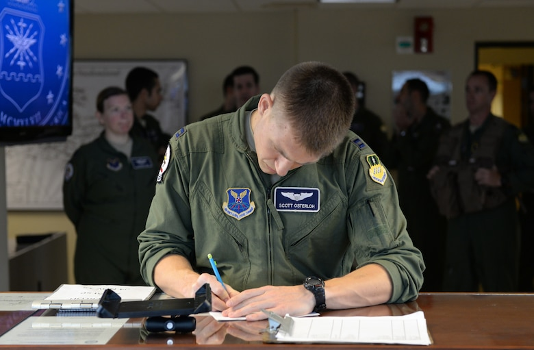Capt. Scott Osterloh, 20th Bomb Squadron commander support staff, makes pre-flight preparations at Barksdale Air Force Base, La., Nov. 3, 2015, prior to a long-range bomber mission to the U.S. European Command area of operations in support of Trident Juncture 2015. During the non-stop sortie, which lasted approximately 26 hours, two B-52 aircrews flew from Barksdale AFB to the exercise area of operations where they executed a show-of-force in Spain, participated in a naval maritime strike scenario, and conducted a large force integration scenario in Portugal. Trident Juncture is the largest NATO exercise conducted in the past 20 years and the highest visibility NATO event planned for 2015. (U.S. Air Force photo/Airman 1st Class Curt Beach)
