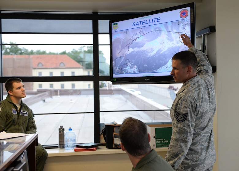 Tech. Sgt. Christopher Watts, 2nd Operations Support Squadron weather technician, briefs aircrew at Barksdale Air Force Base, La., Nov. 3, 2015, prior to a long-range bomber mission to the U.S. European Command area of operations in support of Trident Juncture 2015—the largest NATO exercise conducted in the past 20 years. During the non-stop sortie, which lasted approximately 26 hours, two B-52 aircrews flew from Barksdale AFB to the exercise area of operations where they executed a show-of-force in Spain, participated in a naval maritime strike scenario, and conducted a large force integration scenario in Portugal.(U.S. Air Force photo/Airman 1st Class Curt Beach)