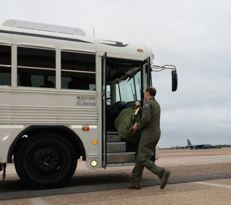 A B-52 aircrew member boards a bus to a B-52 Stratofortress at Barksdale Air Force Base, La., Nov. 3, 2015, prior to a long-range bomber mission to the U.S. European Command area of operations in support of Trident Juncture 2015. During the non-stop sortie, which lasted approximately 26 hours, two B-52 aircrews flew from Barksdale AFB to the exercise area of operations where they executed a show-of-force in Spain, participated in a naval maritime strike scenario, and conducted a large force integration scenario in Portugal. The U.S. Air Force's bomber fleet is assigned to Air Force Global Strike Command and units regularly conduct training with and in support of U.S. Strategic Command, Geographic Combatant Commands, U.S. Allies and partners. (U.S. Air Force photo/Airman 1st Class Curt Beach)