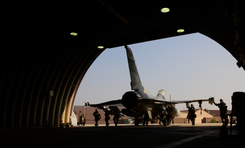 An F-16 Fighting Falcon assigned to the 36th Fighter Squadron is pushed inside a hardened facility by members of the 36th Aircraft Maintenance Unit Nov. 4, 2015, at Osan Air Base, Republic of Korea. More than eight squadrons from three separate bases across Pacific Air Forces are participating in Vigilant Ace 16. Vigilant Ace 16 is a large-scale exercise designed to enhance the interoperability of the U.S. and Republic of Korea Air Forces. (U.S. Air Force photo/Staff Sgt. Benjamin Sutton)