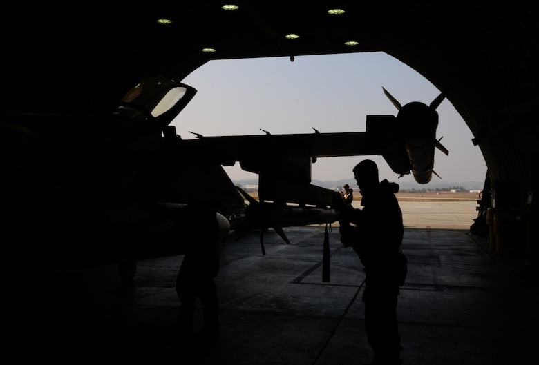 Staff Sgt. Christopher Alteri, 36th Aircraft Maintenance Unit weapons load crew team chief, performs a weapons inspection on an F-16 Fighting Falcon assigned to the 36th Fighter Squadron Nov. 4, 2015, at Osan Air Base, Republic of Korea. The 36th FS is participating in Vigilant Ace 16. Vigilant Ace 16 is a large-scale exercise designed to enhance combat capabilities and interoperability of the U.S. and Republic of Korea Air Forces. (U.S. Air Force photo/Staff Sgt. Benjamin Sutton)