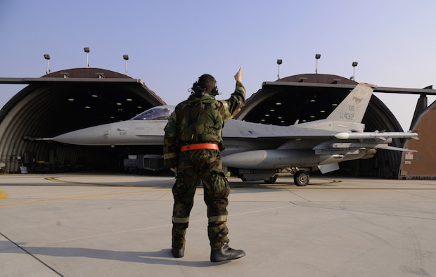 Senior Airman Matthew Self, 36th Aircraft Maintenance Unit crew chief, bids farewell to a pilot inside an F-16 Fighting Falcon assigned to the 36th Fighter Squadron Nov. 4, 2015, at Osan Air Base, Republic of Korea. During Vigilant Ace 16, Airmen launch and recover aircraft during their 12-hour shifts. Vigilant Ace 16 is a large-scale exercise designed to enhance the interoperability of the U.S. and Republic of Korea Air Forces. (U.S. Air Force photo/Staff Sgt. Benjamin Sutton)