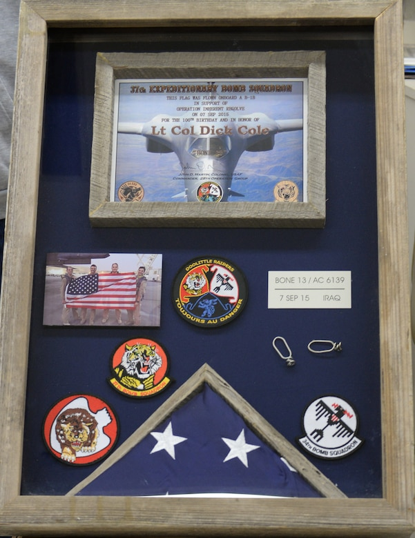 A shadowbox was constructed at Ellsworth Air Force Base, S.D., Oct. 30, 2015, to be presented to retired Lt. Col. Dick Cole, one of two surviving Doolittle Raiders, Nov. 5 at the Pentagon in Arlington, Va. The box holds memorabilia from Ellsworth, along with a flag that was flown during a combat mission on Cole's 100th birthday. (U.S. Air Force photo by Senior Airman Rebecca Imwalle/Released)