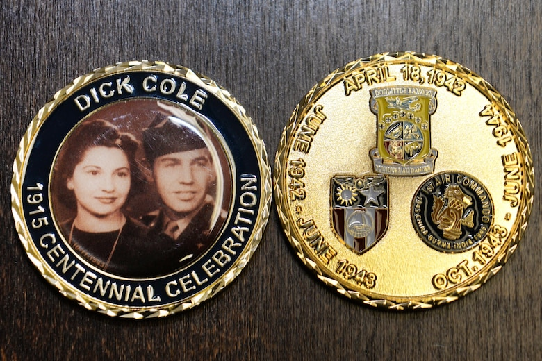 The 28th Operations Group received nine challenge coins from retired Lt. Col. Dick Cole, one of two surviving Doolittle Raiders, to thank the Airmen who flew a flag during a combat mission on his 100th birthday Sept. 7, 2015. The 37th Bomb Squadron honored Cole's actions as a Doolittle Raider and strives to emulate the Raider's legacy of dedication, sacrifice and boldness. (U.S. Air Force photo by Senior Airman Rebecca Imwalle/Released)