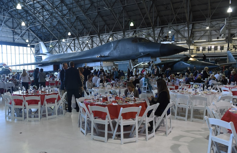 Crowds of past and present service members, along with community leaders, begin finding their seats during the Aurora Veteran Salute event Nov. 4, 2015, at Wings Over the Rockies Air and Space Museum. The event is held every year to honor WWII veterans and celebrate the 70th anniversary of the end of WWII. (U.S. Air Force photo by Airman 1st Class Samantha Meadors/Released)