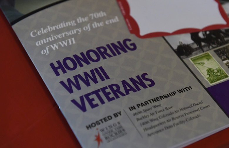 An Aurora Veteran Salute pamphlet is placed at each seat Nov. 4, 2015, at Wings Over the Rockies Air and Space Museum. The event is held every year to honor WWII veterans and celebrate the 70th anniversary of the end of WWII. (U.S. Air Force photo by Airman 1st Class Samantha Meadors/Released)