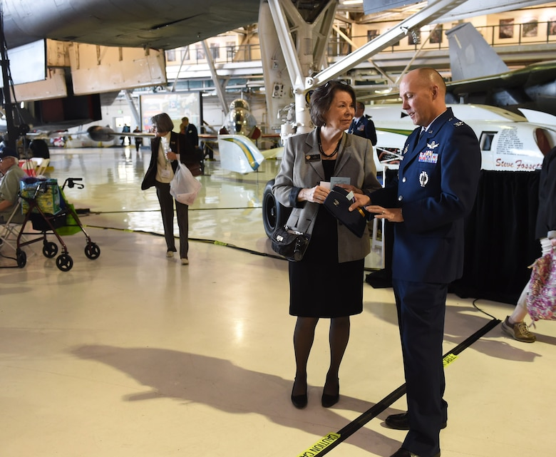 Col. Scott Romberger, 460th Vice Wing commander, and Representative Su Ryden, State House District 36, talk during the Aurora Veteran Salute event Nov. 4, 2015, at Wings Over the Rockies Air and Space Museum. The event is held every year to honor WWII veterans and celebrate the 70th anniversary of the end of WWII. (U.S. Air Force photo by Airman 1st Class Samantha Meadors/Released)
