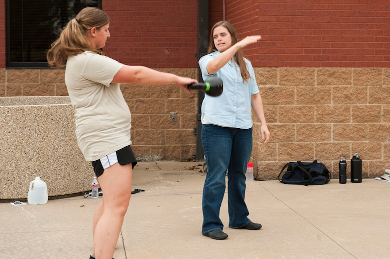 From right, Jill Hinsley, 19th Aerospace Medicine Squadron registered dietician, teaches U.S. Air Force Staff Sgt.  Kendra Mcalpin, 19th Logistic Readiness Squadron aircraft part store supervisor, proper techniques for kettlebell swings Nov. 4, 2015, at Little Rock Air Force Base, Ark. Vital 90 is geared toward helping Airmen stay Fit-to-Fight. (U.S. Air Force photo by Senior Airman Stephanie Serrano)