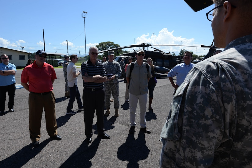 U.S. Army Chief Warrant Officer Daniel Keslar, 1-228 Aviation Regiment pilot, talks to members of Congress on Soto Cano Air Base, Honduras, Nov. 1,2015, informing them of the mission capabilities and their operations in the Central American area of responsibility. The Congressional members visited Soto Cano and U.S. Embassies in Honduras and Guatemala during their visit to the Central American region. (U.S. Air Force photo by Senior Airman Westin Warburton/Released)