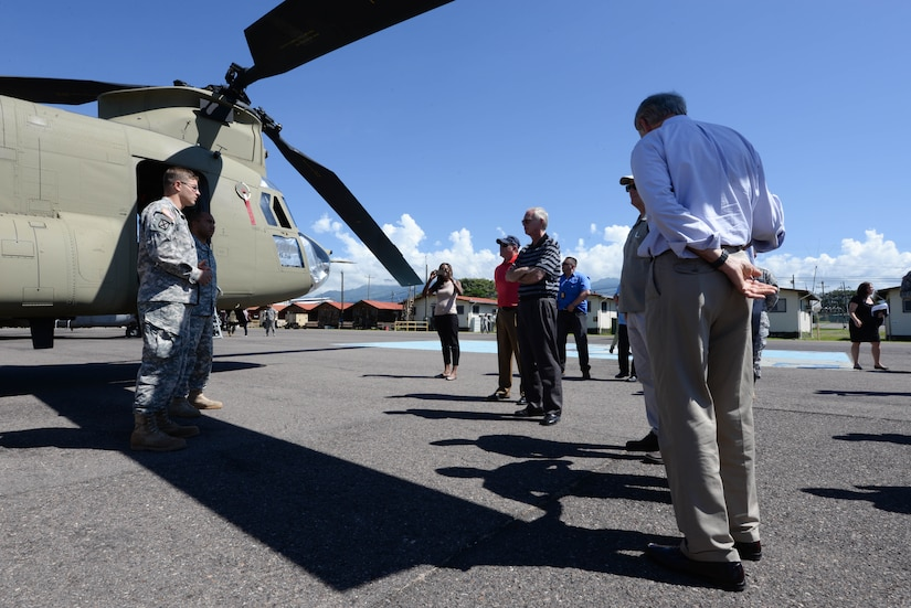 U.S. Army Chief Warrant Officer Daniel Keslar, 1-228 Aviation Regiment pilot, and Sgt. Matthew Teleha, 1-228 AR flight engineer, talk to members of Congress on Soto Cano Air Base, Honduras, Nov. 1,2015, informing them of the mission capabilities of the CH-47 Chinook helicopter and UH-60 Blackhawk helicopter (not pictured), and their operations in the Central American area of responsibility. The Congressional members visited Soto Cano and U.S. Embassies in Honduras and Guatemala during their visit to the Central American region. (U.S. Air Force photo by Senior Airman Westin Warburton/Released)