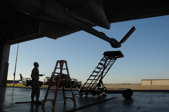 U.S. Air National Guard Master Sgt. Travis Metcalf, a crew chief with the 185th Air Refueling Wing, Iowa Air National Guard, oversees lowering of the boom on an Air Force KC-135 Stratotanker, November 3, 2015. The boom is being lowered while in the fuel cell hangar in Sioux City, Iowa in preparation for washing as part of a scheduled 180 day aircraft wash.