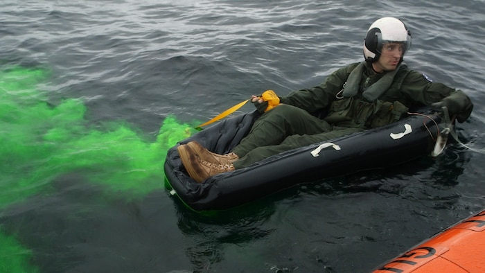 A Marine deploys a sea dye marker during a search and rescue exercise off the coast of Charleston Nov. 3. Sea dye markers contain a fluorescent green dye that spreads over the surface of the water to signal rescue pilots. The Marine is a pilot is with Marine All Weather Fighter Attack Squadron 533, Marine Aircraft Group 31.
