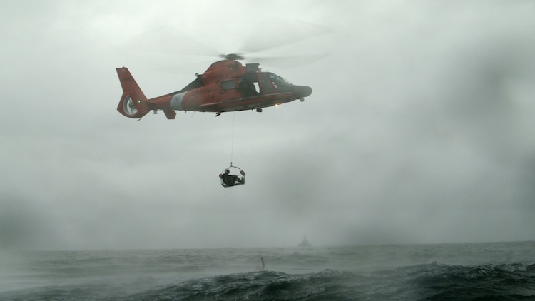 A Coast Guard HH-65 Dolphin lifts a Marine during a search and rescue exercise off the coast of Charleston Nov. 3. The purpose of this exercise is to test the capabilities and procedures of the Marine Corps and Coast Guard in a real world scenario. The Marine is a pilot with Marine All Weather Fighter Attack Squadron 533, Marine Aircraft Group 31.