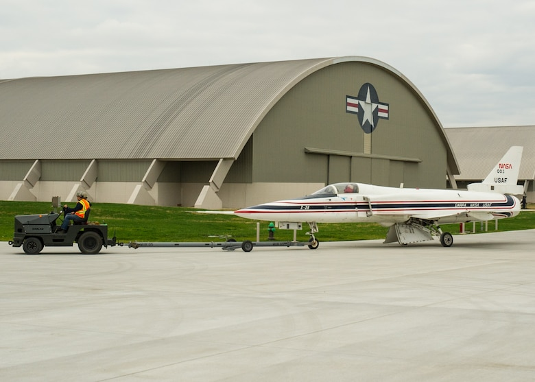 Restoration staff move the Grumman X-29A into the new fourth building at the National Museum of the U.S. Air Force on Nov. 5, 2015. (U.S. Air Force photo by Ken LaRock)