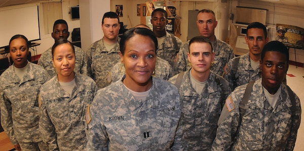 Army Capt. Rolona Brown, the commander of Echo Company, 266th Quartermaster Battalion, stands with advanced individual training soldiers assigned to her unit at Joint Base Langley-Eustis. The High Point, N.C., native was one of three women selected to appear in a Lifetime channel documentary focusing on military women. U.S. Army photo by Terrance Bell