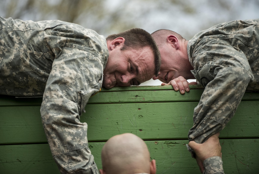Sgt. Lloyd Russell, of Fredericktown, Mo., and Sgt. Ian Flanagan, of Carthage, Ind., U.S. Army Reserve military police Soldiers, try to pull a teammate up to a wall during a Leadership Reaction Course at Camp Atterbury, Ind., Nov. 5, during a three-day range training event hosted and organized by the 384th Military Police Battalion, headquartered at Fort Wayne, Ind. The field training involving more than 550 U.S. Army Reserve Soldiers and included ranges using eight different weapons systems, plus combat patrolling and a rifle marskmanship competition. (U.S. Army photo by Master Sgt. Michel Sauret)