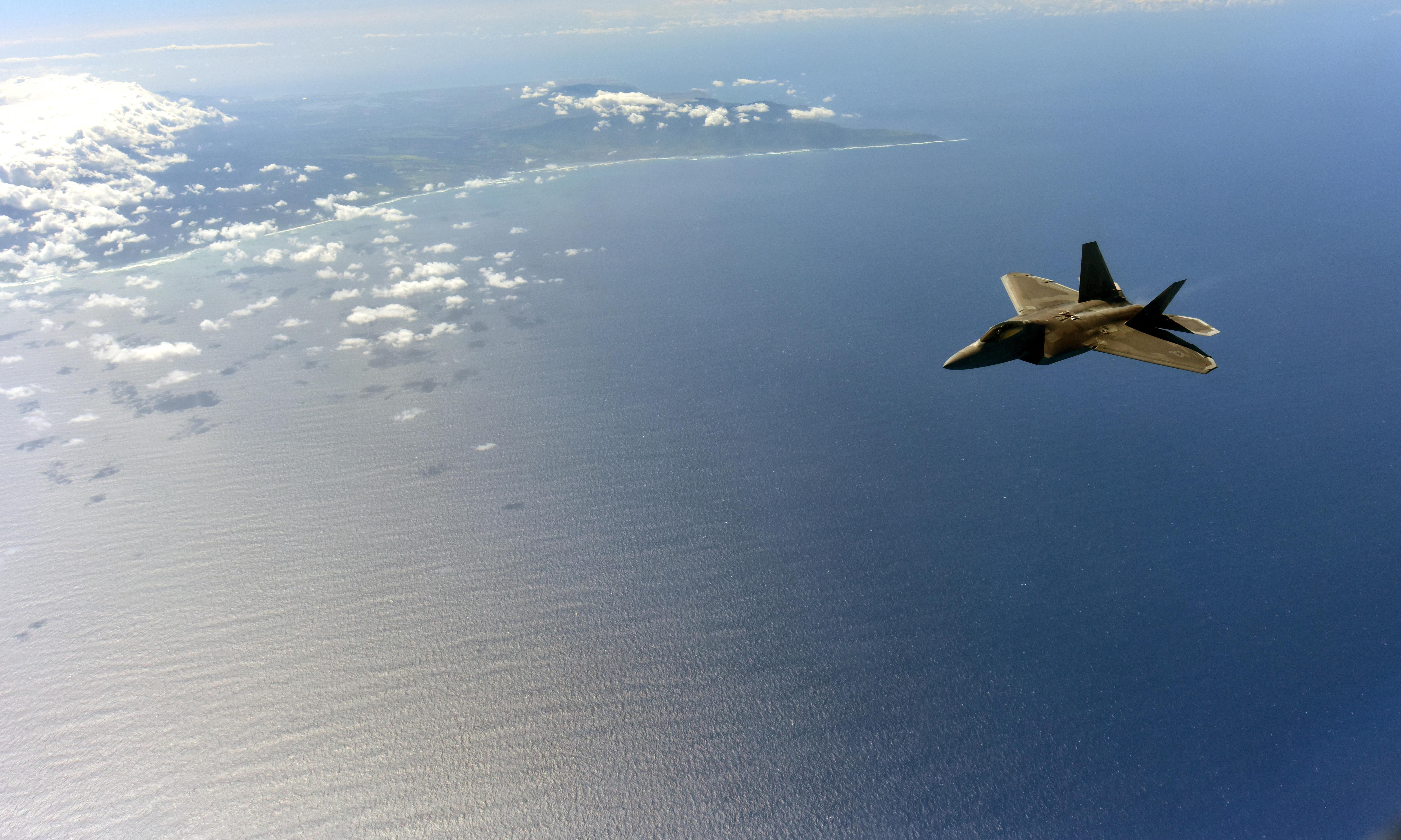 What Is Pearl Harbor Day >> An F-22 Raptor from the 199th Fighter Wing soars over the island of Oahu as a part of Warrior ...