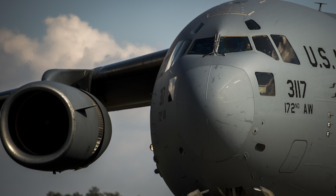 A Mississippi Air National Guard pilot from the 172nd Airlift Wing looks out the window during an engine run offload on the flightline at Camp Shelby Joint Forces Training Center, Miss., during Exercise Turbo Distribution Oct. 29, 2015. The U.S. Transportation Command exercise tests the joint task force-port opening's ability to deliver and distribute cargo during humanitarian relief operations. (U.S. Air Force photo/Staff Sgt. Marianique Santos)