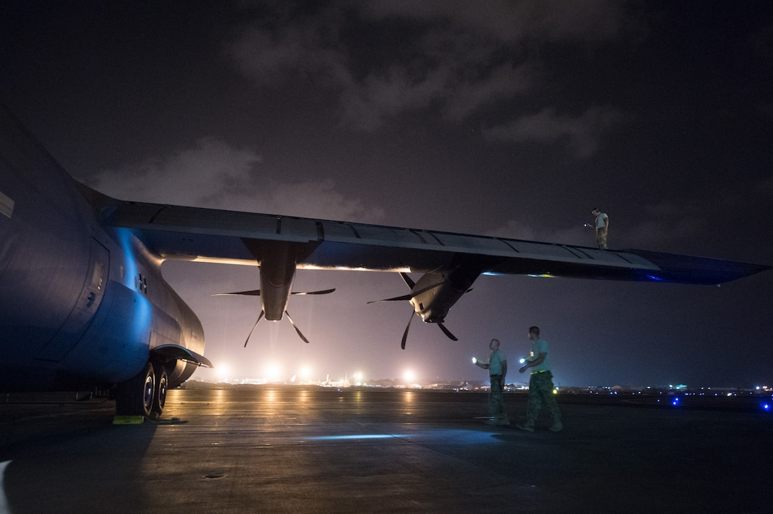 Aircraft maintainers assigned to Combined Joint Task Force-Horn of Africa conduct a post-flight inspection on a C-130 Super Hercules at Camp Lemonnier, Djibouti, Oct. 30, 2015. Through unified action with U.S. and international partners in East Africa, CJTF-HOA conducts security force assistance, executes military engagement, provides force protection and military support to regional counter-violent extremist organization operations in order to support aligned regional efforts, and ensures regional access and freedom of movement, as well as protecting U.S. interests. (U.S. Air Force photo/Tech. Sgt. Barry Loo)