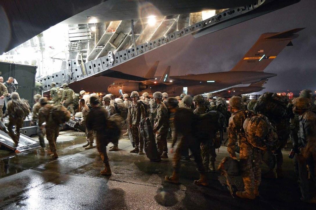 Army paratroopers from the 2nd Brigade Combat Team, 82nd Airborne Division, load onto an Air Force C-17 Globemaster III aircraft during exercise Ultimate Reach Nov. 3, 2015, on Pope Army Airfield, N.C. Ultimate Reach is an annual U.S. Transportation Command-sponsored live-fly exercise designed to exercise the ability of the 18th Air Force to plan and conduct strategic airdrop missions. (U.S. Air Force photo/Marvin Krause)