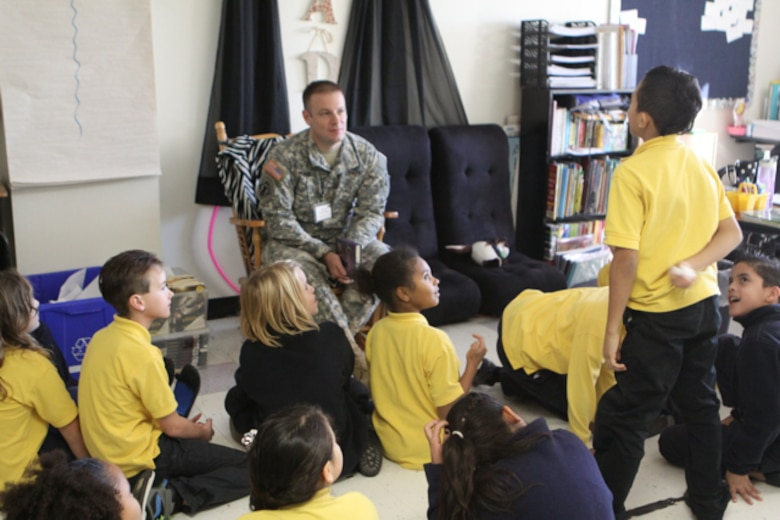 """U.S. Army Corps of Engineers (USACE), Buffalo District Deputy District Commander MAJ Jared E. Runge reads to elementary school students to support the """"Celebration of Reading"""" program."""