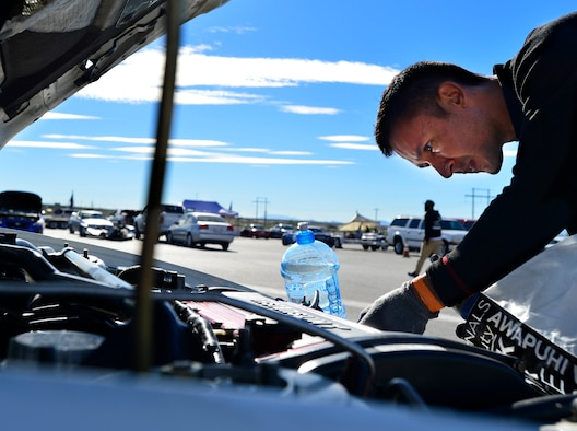 Tech. Sgt. Gabriel, a 432nd Wing/432nd Air Expeditionary Wing MQ-9 Reaper sensor operator, inspects his Mitsubishi Lancer Evolution at the Spring Mountain Raceway Nov. 1, 2015, in Pahrump, Nevada. Gabriel has owned and modified his Evolution for over five years. (U.S. Air Force photo/Airman 1st Class Christian Clausen)