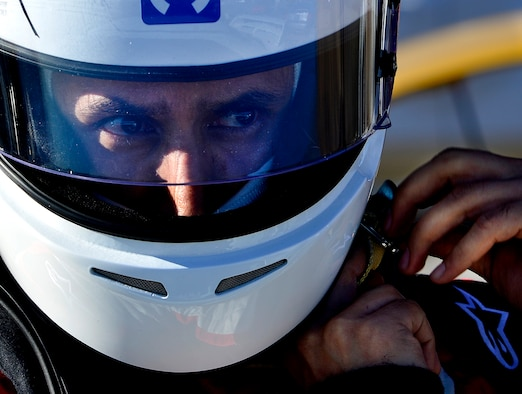 Tech. Sgt. Gabriel, a 432nd Wing/432nd Air Expeditionary Wing MQ-9 Reaper sensor operator, puts his helmet on before racing his Mitsubishi Lancer Evolution at the Spring Mountain Raceway Nov. 1, 2015, in Pahrump, Nevada. Gabriel balances his life between a highly stressful, yet rewarding career, with his passion for cars and racing. (U.S. Air Force photo/Airman 1st Class Christian Clausen)