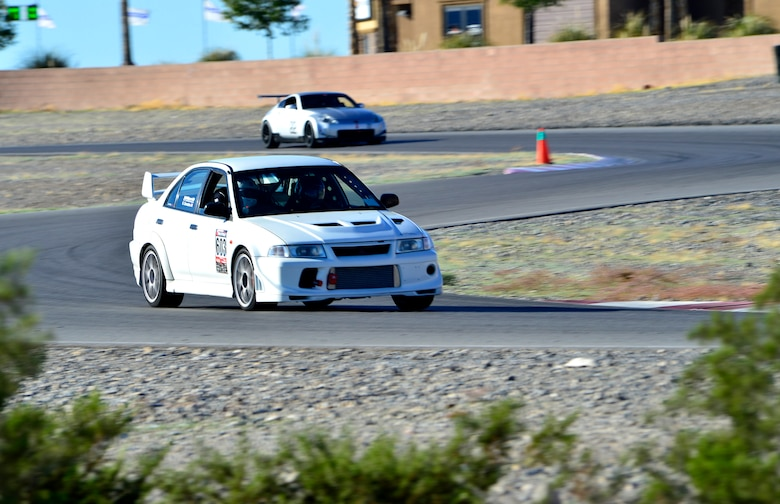 Tech. Sgt. Gabriel, a 432nd Wing/432nd Air Expeditionary Wing MQ-9 Reaper sensor operator, races his Mitsubishi Lancer Evolution at the Spring Mountain Raceway Nov. 1, 2015, in Pahrump, Nevada. Gabriel has owned and modified his Evolution for over five years. He's upgraded everything from the engine, suspension, brakes, and safety equipment to compete in time attack style racing. (U.S. Air Force photo/Airman 1st Class Christian Clausen)